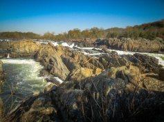 Whitewater rapids carve a path through a treacherous rocky landscape.