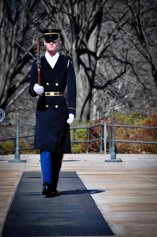 Guard walking the mat at the Tomb