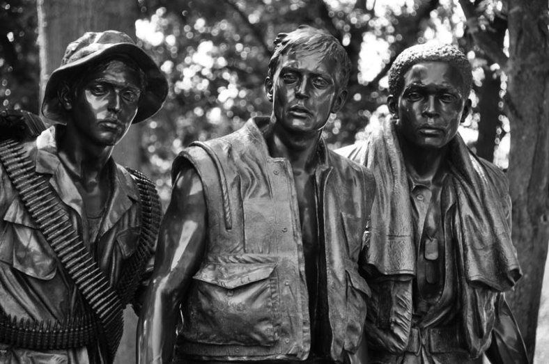 Close-up view of the faces of the three servicemen.