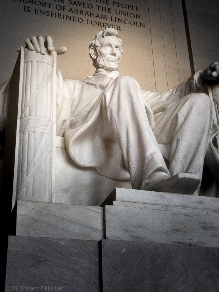 Looking up at the statue, with the end of the epitaph visible above Lincoln's head.