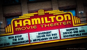 Red and yellow movie marquee in Hamilton, New York.