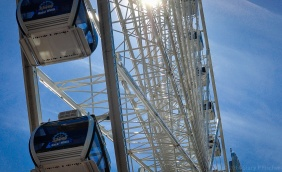 The top half of the Great Wheel, against a bright blue sky.