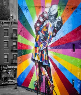 "Color mural on building of the iconic photo of ""Sailor Kissing Woman"" in Times Square on V-J Day."