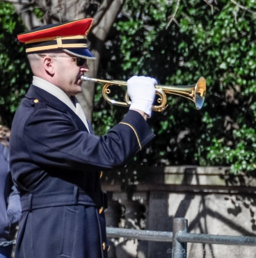 "Bugler plays ""Taps."""