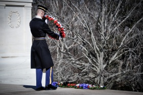 Honor Guard carries a wreath to the front of the Tomb to lay it down with other wreaths presented that day.