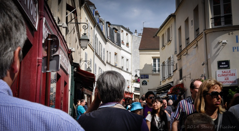 View admidst pedestrians of a busy street in Montmarte