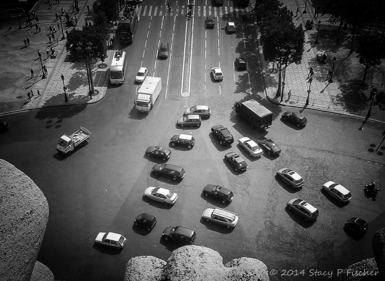 From atop the Arc de Triomphe, a view of the every-which-way-traffic in the roundabout adjacent to the Champs-Elysées.