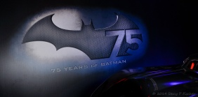 75th Anniversary of Batman logo displayed with classic batmobile in front.