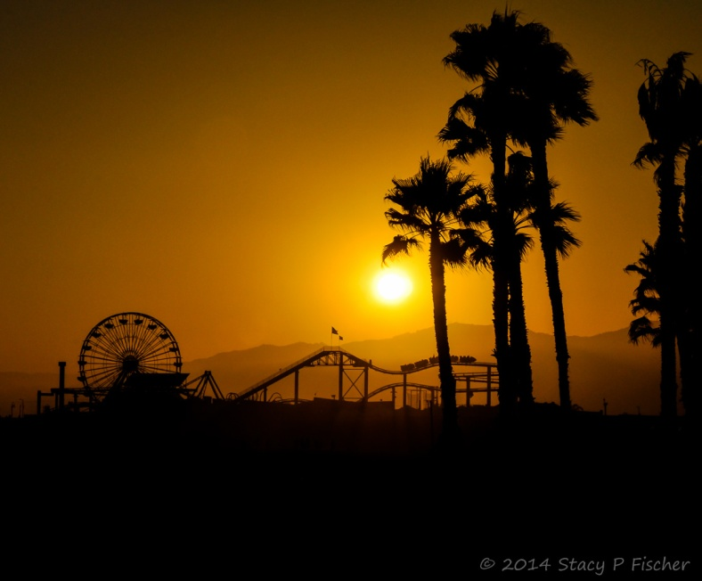 Santa Monica Pier silhouetted against setting sun
