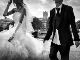 Bride and groom on IŽle Saint Louis, Paris, with the River Seine in the background.