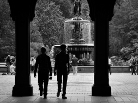 Bethesda Fountain Central Park with silhouetted visitors