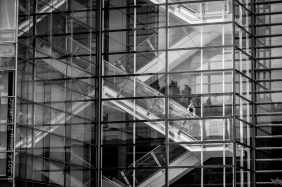 Reflections of escalators on exterior of The Newseum in Washington, DC