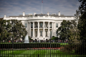 The White House and south lawn viewed through the fence.