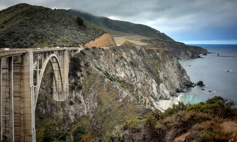A view of Bixby Bridge and the cliffs of California's coastline from the Pacific Coast Highway looking south.
