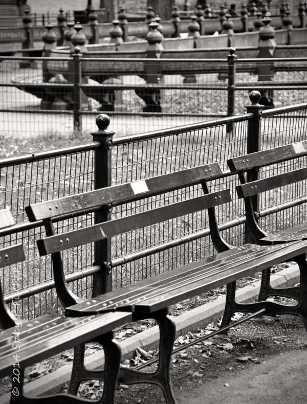 Patterns and angles created by Central Park benches and fences.