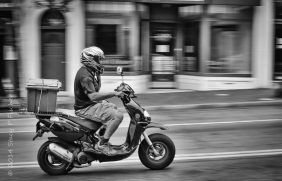 Panning motion of passing motorcyle