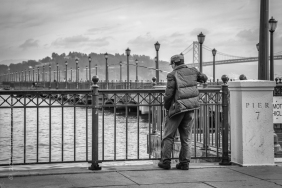 Fisherman at Pier 7 with the backdrop of the Oakland Bay Bridge
