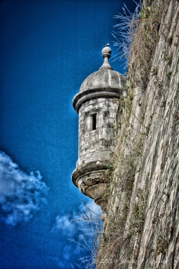 Stylized color photo of guerita (sentry box) on San Juan's fortified wall.