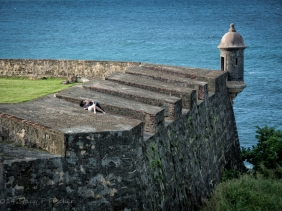 Guerite or sentry box in San Juan with Atlantic Ocean and snuggling couple.