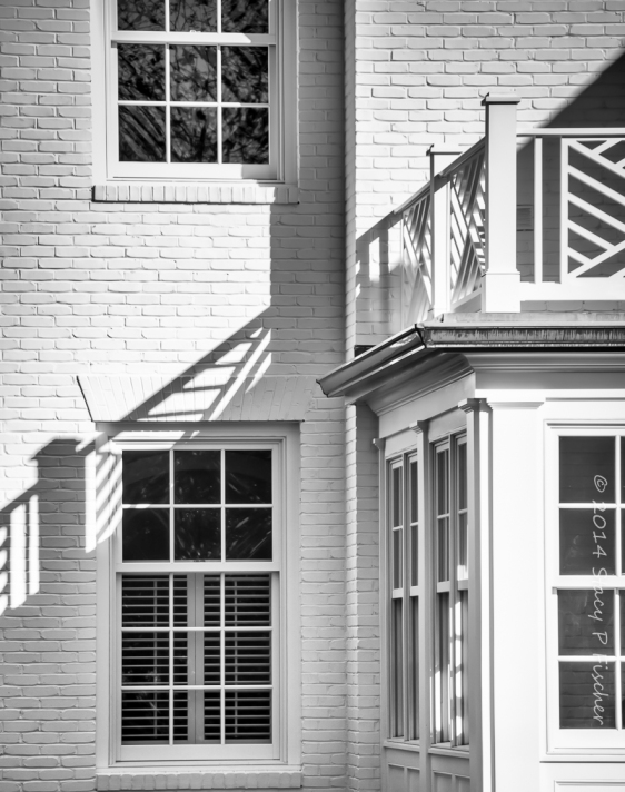 Windows and Shadows cast in the corner exterior of a house
