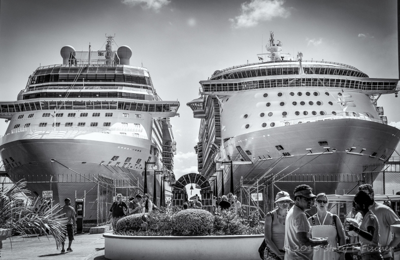 Cruise ships docked side by side in port.