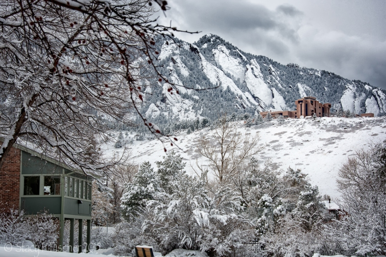 NCAR (National Center for Atmospheric Research) against a backdrop of snow-covered mountains.