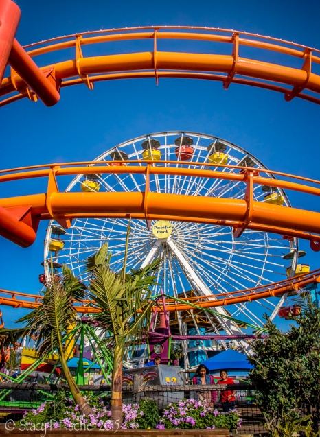 The bright orange track of the West Coaster rollercoaster at Santa Monica's famed Pacific Park.