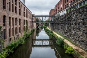 Georgetown, Washington, DC canal looking north toward pedestrian bridges between business buildings