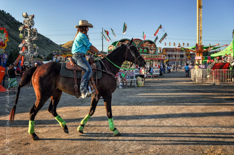 Cowgirl and horse ready for a rodeo at a county fair