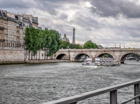 The Seine, a Bateaux Mouches, Pont Neuf, Eiffel Tower, and Institut de Paris.