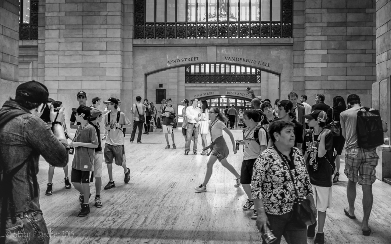 A couple poses for a Grand Central Station photo shoot
