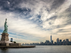 Statue of Liberty overlooking One World Trade Center