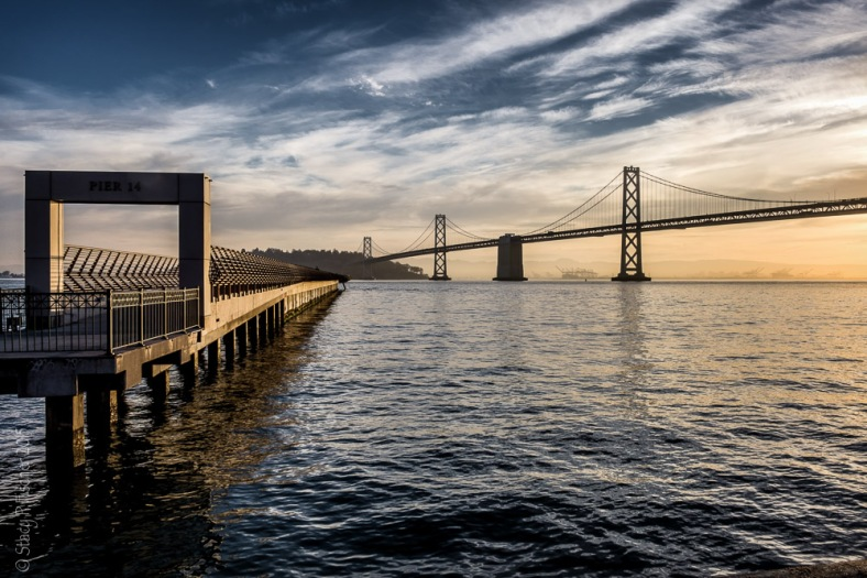 San Francisco Embarcadero Pier 14 sunrise with Oakland Bay Bridge