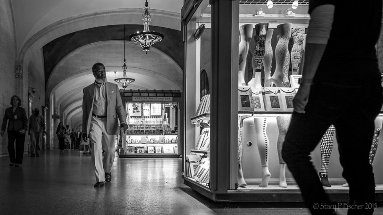 Gentleman eyeing a hosiery display in NYC Grand Central Station kiosk.