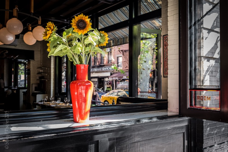 "Sunflowers in the open window of ""The Dutch"" in New York City, South Village"