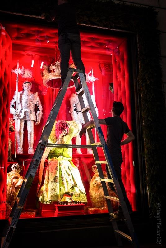 Employees work on unveiling Bergdorf Goodman's 2015 Christmas windows