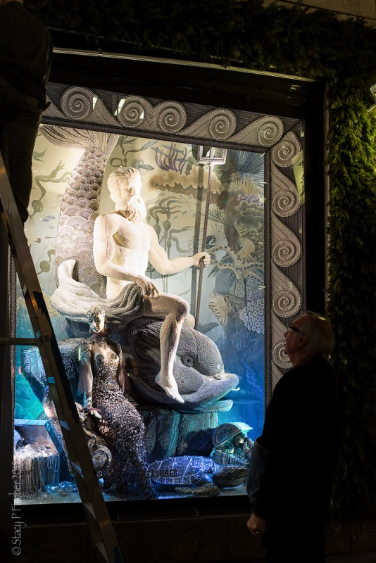 Employees work on unveiling Bergdorf Goodman's 2015 Christmas windows