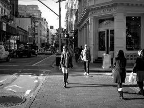 Sidelight illuminates pedestrians in SoHo, New York City