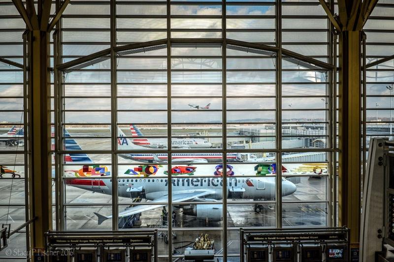 Plane taking off, as seen through window of Terminal C, Ronald Reagan National Airport