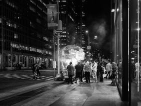Late night New York City food cart customers