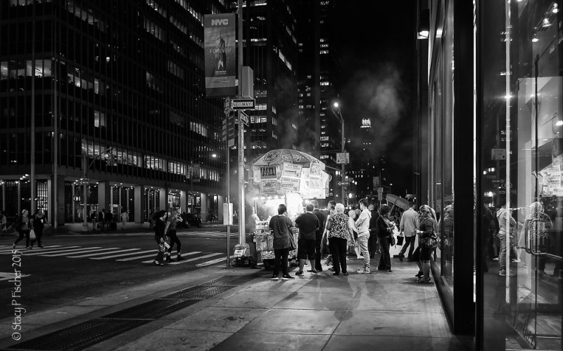 Late night New York City food cart customers