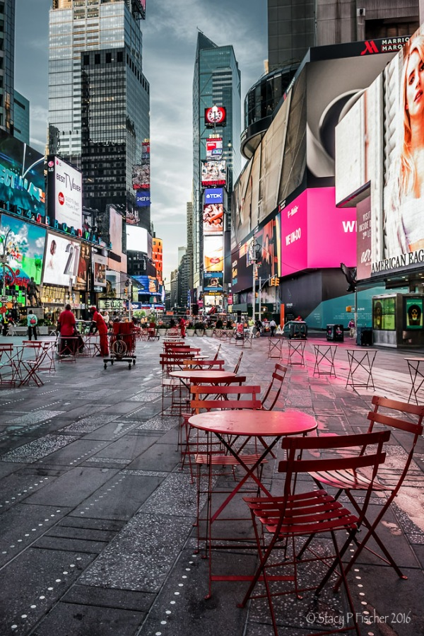 Tables being set up in Times Square, early morning.