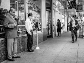 Smoking, coffee, iPhones on urban street