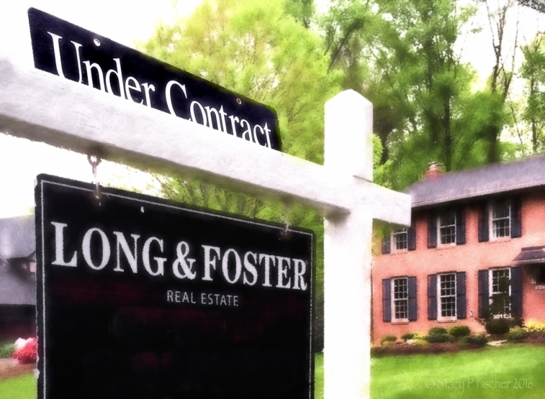 Under Contract sign in front of a house