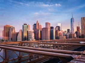 Lower Manhattan sunrise viewed from the Brooklyn Bridge