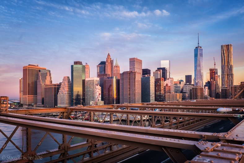 Lower Manhattan sunrise viewed from the Brooklyn Bridge