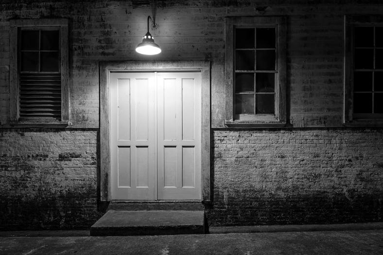 Door at Alcatraz lit at night