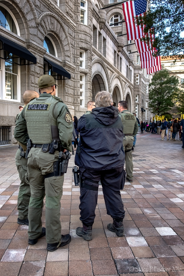 Police and SWAT personnel stand at the ready at Trump Hotel Washington DC protest